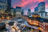 Tokyo Railway Station And Tokyo Highrise Building At Twilight Time In Tokyo, Japan. poster