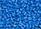 stock photo of thermoplastics  - close up of blue dyed polymer resin for injection moulding - JPG