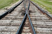 picture of merge  - A set of railway tracks merging in Morden, Manitoba, Canada ** Note: Shallow depth of field - JPG