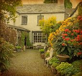 stock photo of english cottage garden  - garden at the front of  old house - JPG
