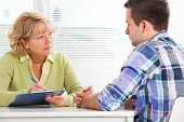 image of medical examination  - Doctor talking to her male patient at office - JPG