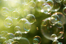 stock photo of zero  - Soap bubbles floating in the air as the Summer sun sets - JPG