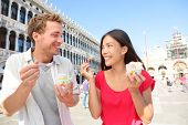 foto of gelato  - Couple eating ice cream on vacation travel in Venice - JPG