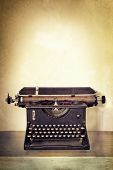 picture of old vintage typewriter  - Vintage typewriter on old desk with grunge background - JPG