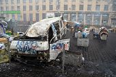 KIEV, UKRAINE - FEB 10, 2014: Downtown of Kiev.Situation in the city.Burned car. Riot in Kiev and We