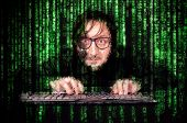 stock photo of virus scan  - Hacker in Action on the keyboard with matrix background - JPG