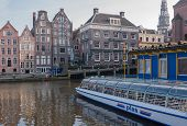Tour Boat And Canal Houses In Amsterdam
