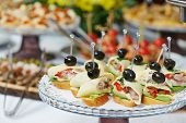 stock photo of catering  - catering services background with snacks and food in restaurant - JPG