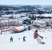 MONT-TREMBLANT, QC, CANADA -FEBRUARY 9: Skiers and snowboarders are sliding down the main slope at M