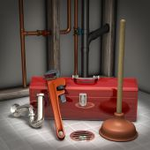 stock photo of plumbing  - Plumbers toolbox plunger pipe wrench and sink trap on a tiled floor with exposed pipes in the background - JPG