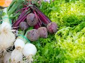 foto of scallion  - Beet scallion and endive in a market - JPG