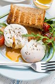 Healthy breakfast : Poached Eggs, Wholegrain Bread, Orange Juice, Fruit and Vegetables