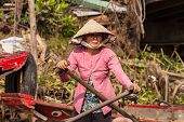 Portrait of Vietnamese woman rowing a boat