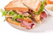 pic of pickled vegetables  - Delicious thinly sliced beef pastrami club sandwich with fresh curly lettuce served with a small dish of pickled vegetables on a white plate isolated on white - JPG