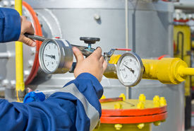 picture of barometer  - Operator working on barometer of oil and gas refinery - JPG