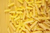 Background Macaroni On Long Spaghetti. Close Up . poster