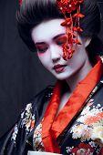 foto of geisha  - young pretty geisha in kimono with sakura and decoration - JPG