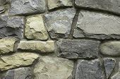 picture of stonewalled  - Fragment of texrured stonewall useful as background - JPG