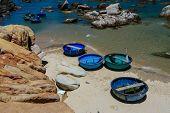 stock photo of coracle  - Basket boats at Ke Ga beach  - JPG