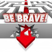 foto of daring  - Be Brave word in red 3d letters over arrow crashing through maze wall illustrating confidence - JPG