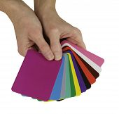 picture of self assessment  - Color therapist holding a selection of different colored cards fanned out and gesturing to take one - JPG