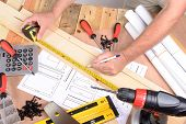 pic of carpentry  - a man made a piece of furniture with various carpentry tools - JPG