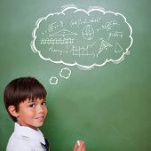picture of math  - Math in thought bubble against cute pupil holding chalk - JPG