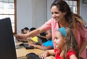 pic of pupils  - Cute pupils in computer class with teacher at the elementary school - JPG