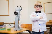 foto of half-dressed  - Cute pupil dressed up as scientist in classroom at the elementary school - JPG