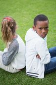 foto of not talking  - Young friends not talking to each other after fight in the park - JPG