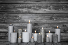 picture of sad christmas  - Burning candles in white and grey on wooden shabby chic background. Idea for a card for mourning death or christmas. - JPG