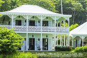 picture of victorian houses  - A victorian style beach hotel resting among palm trees - JPG