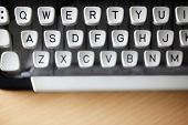 pic of qwerty  - Typewriter qwerty keys on wooden desk - JPG