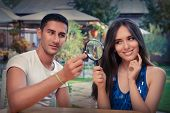 image of propose  - Young couple getting engaged in funny wedding proposal scene - JPG