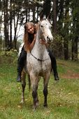pic of appaloosa  - Beautiful girl riding a horse without bridle or saddle in autumn - JPG