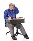 foto of scratching head  - A mature student scratching his head as he works a problem from a retro child - JPG