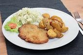 foto of wieners  - Wiener schnitzel with fried potato wedges and cabbage salad - JPG