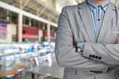 stock photo of catering service  - Business Man standing in front of Blur Background of Restaurant as catering or food service business - JPG