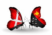 picture of papua new guinea  - Two butterflies with flags on wings as symbol of relations Denmark and Papua New Guinea - JPG
