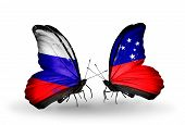 stock photo of samoa  - Two butterflies with flags on wings as symbol of relations Russia and Samoa - JPG