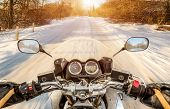 picture of slippery-roads  - Biker rides on winter slippery road - JPG