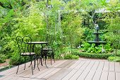 pic of english cottage garden  - Black chair in the garden for ralex - JPG