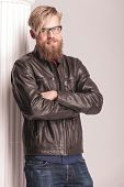 pic of long beard  - Smiling long beard man standing near a white column with his hands crossed - JPG