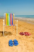 stock photo of nudism  - deckchair swim suit and flip - JPG