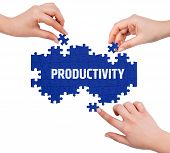 stock photo of productivity  - Hands with puzzle making PRODUCTIVITY word isolated on white - JPG