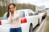 stock photo of tow-truck  - Woman calling while tow truck picking up her car - JPG