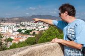 picture of tourist-spot  - Tourist visiting the Alcazaba of Malaga shows parts of the underlying city - JPG