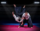 stock photo of aikido  - Fight between two aikido fighters at sport hall - JPG