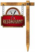 image of food chain  - Restaurant sign with metal frame white plate with silver cutlery - JPG