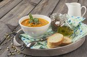 stock photo of ginger-bread  - Soup of carrots with ginger on old table background - JPG